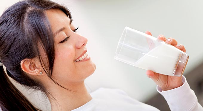 Southeast Dairy Association - Hispanic woman drinking milk