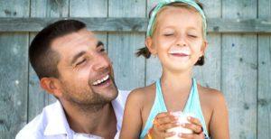 Dad and Daughter Enjoying Milk
